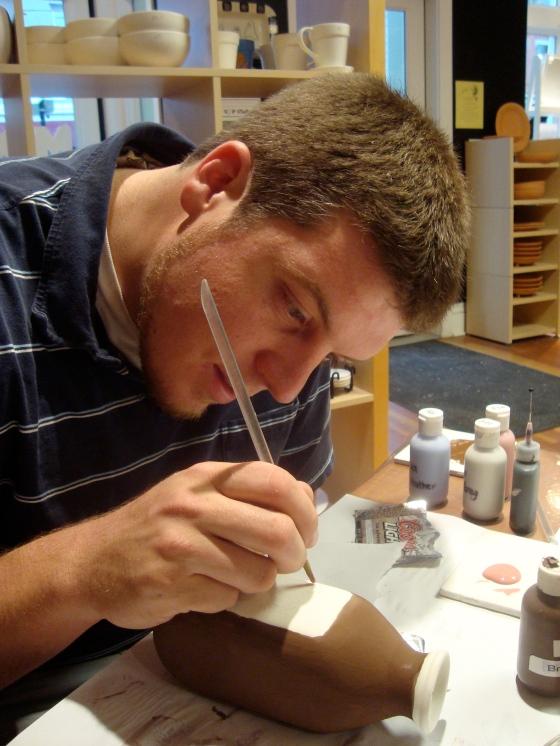 Mr. Gaunt painting his Coors Light milk bottle